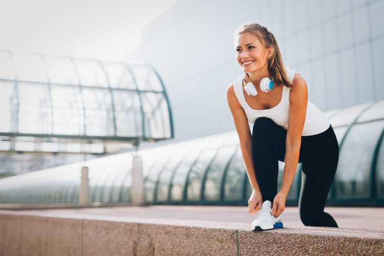 Happy woman ready for the run - Three vital tips for the beginner's fitness journey